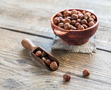 Bowl of hazelnuts on the wooden board