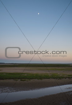 Beautiful low tide beach landscape during twilight in Sumer