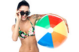 Sensual bikini woman with a beach ball
