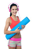 Woman enjoying music after workout