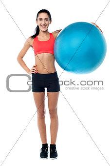 Fitness trainer holding pilates ball