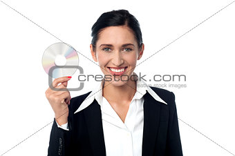 Business woman holding compact disc