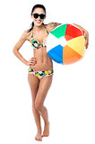 Bikini woman holding colorful beach ball