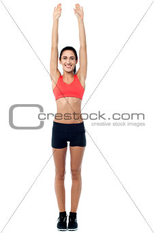 Fitness enthusiast stretching her arms