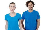 Couple in blue t-shirts. Isolated over white.