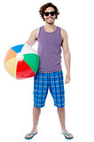 Cheerful guy ready to play beach ball