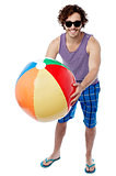 Man with a colorful big beach ball
