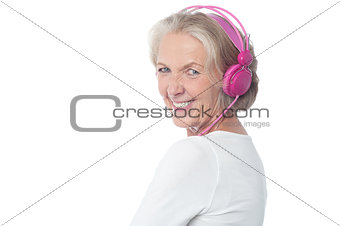 Aged woman enjoying today's music