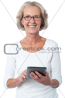 Aged woman with touch pad device