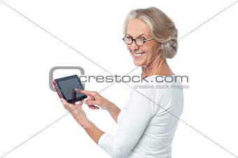 Aged lady operating touch pad device