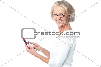 Old lady using tablet pc device