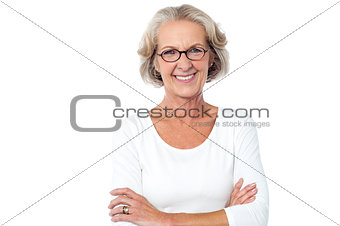 Beautiful aged woman with crossed arms