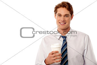 Corporate man holding cold beverage