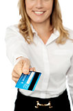 Cropped businesswoman displaying cash card