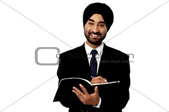 Business guy writing down key points