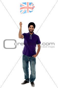 Causal guy waving United Kingdom flag