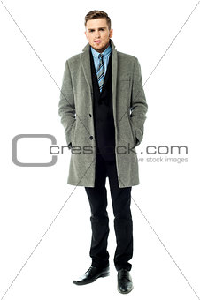 Corporate guy wearing long overcoat