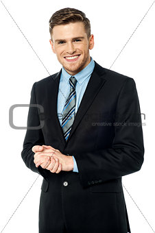 Corporate guy posing with clasped hands
