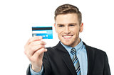 Businessman displaying his cash card