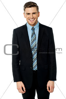 Smiling businessman posing casually