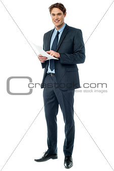 Businessman checking data printed on the list