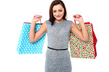 Youngg woman with shopping bags