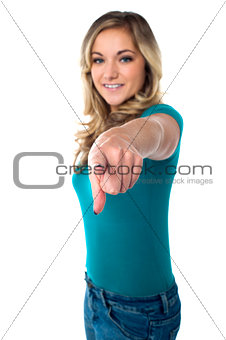 Cute young girl pointing you out