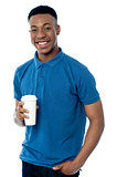 Smiling man holding cold beverage