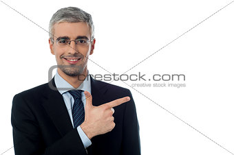 Businessman pointing at something