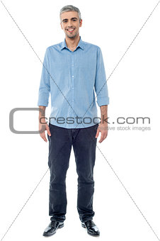 Relaxed middle age man posing casually