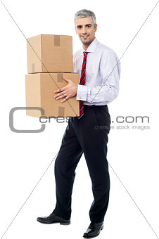 Corporate man holding stack of parcel boxes