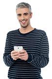 Senior man on smart phone