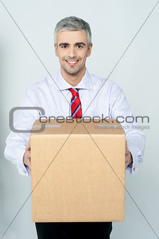 Smiling aged delivery man