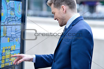 Businessman checking a bus timetable