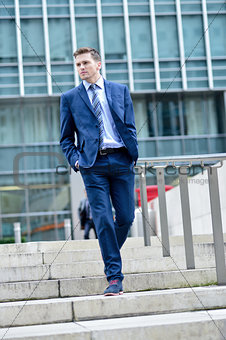 Business man walking down some steps