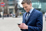 Young businessman using his mobile phone