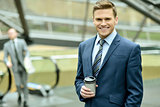 Businessman with coffee sipper