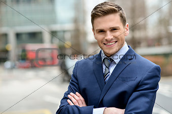 Smiling businessman posing for the camera