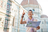 Young woman with map in front of cattedrale di santa maria del f