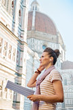 Young woman with map and audio guide in front of cattedrale di s
