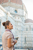 Happy young woman with tablet pc in front of cattedrale di santa