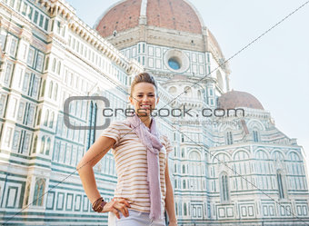 Portrait of happy young woman standing in front of cattedrale di