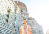 Happy young woman in front of cattedrale di santa maria del fior