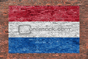 Flag of Netherlands painted over brick wall