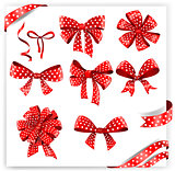 Set of red polka dot gift bows with ribbons.