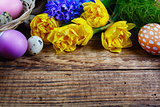 Easter decorations on old wooden background close up