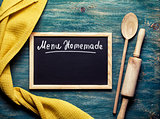 Kitchen tools and Black board on with text