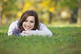 Happy Teen Laying On Grass
