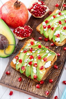 Avocado sandwich with feta and pomegranate
