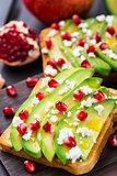 Avocado sandwich with feta and pomegranate